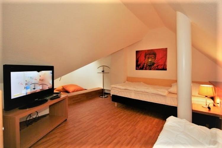 Dachgalerie mit Einzelbetten Haus 8