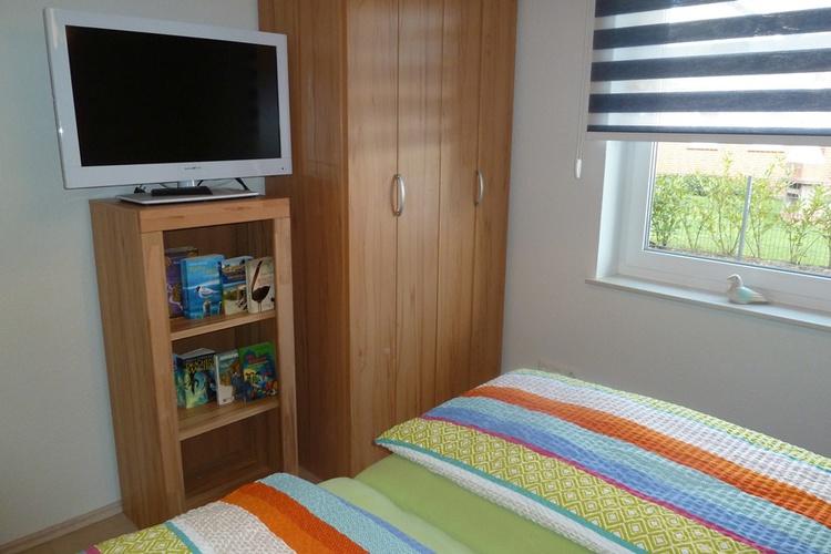 Schlafzimmer mit zusätzlichem Flach-Bild-TV
